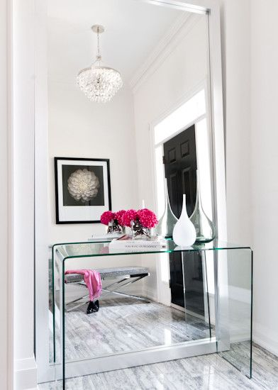 Niche in a small space? Foyer? Instead of the ol' console table with mirror, a floor to nearly-ceiling leaning mirror behind. Brilliant.: