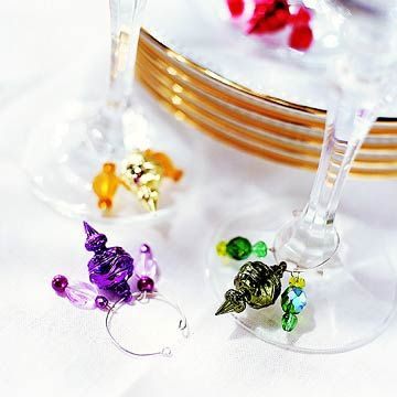 Simply Charming Wine Charms  Make no mistake -- guests can find their drinks when each piece of stemware sports a different-color charm. For a festive look, use a miniature Christmas ornament for the center charm.