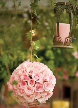 candle and flowers in pink
