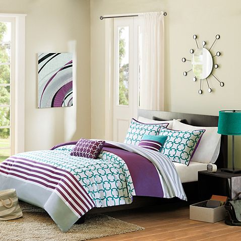 Halo Reversible Comforter Set in Teal. Bring a vibrant look to your bedroom with the lively Halo Reversible Comforter Set. Adorned with a teal and white checkered print, horizontal purple stripes and a grey stripe, the youthful bedding is show-stopping addition to any room's décor.