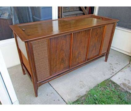 Vintage 1969 Magnavox Console Stereo just like mine, except that I took out the grills and gold fabric and replaced it with just black speaker fabric