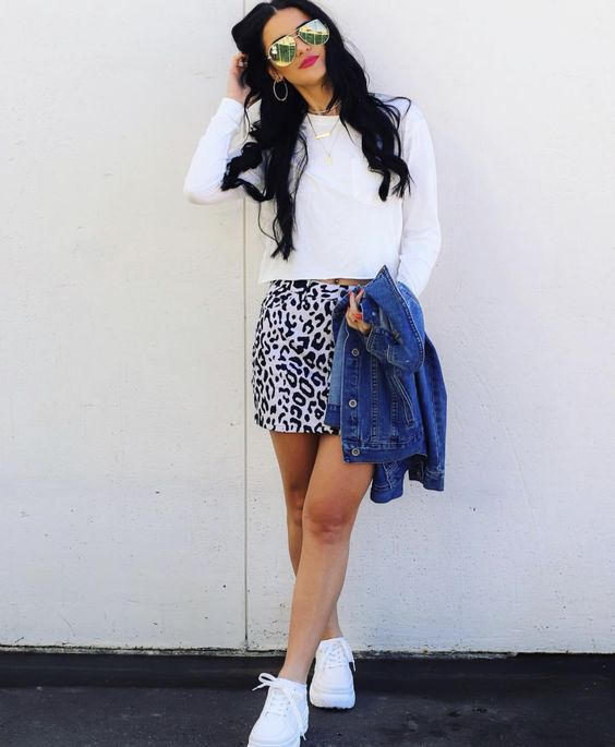 Long sleeved basic crop top with a denim jacket, printed mini skirt, and chunky sneakers
