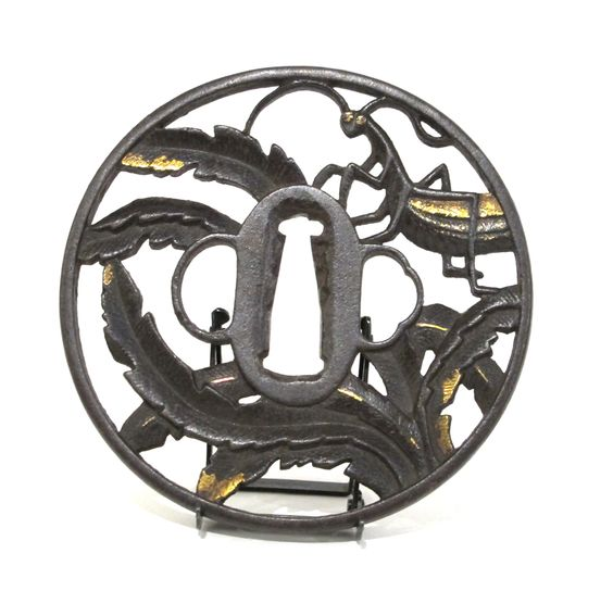 Marugata iron Tsuba decorated with a praying mantis in leaves, Japan, Early Edo 1700-1750