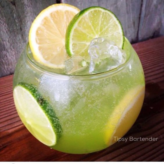 KEY LARGO ZEST Build in fishbowl glass with lemon and lime wheels and ice. 1 oz. (30 ml) Cruzan Vanilla Rum 1 oz. (30 ml) Cruzan Key Lime Rum 1 oz. (30 ml) Deep Eddy Lemon Vodka 1 oz. (30 ml) Midori Melon Liqueur 2 oz. (60 ml) Lemonade Top off with Lime flavored Tonic Water This cocktail glows under a black light because of the tonic water.