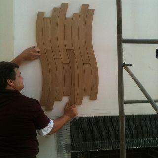 This wood tile will go all the way up our 22-foot fireplace wall