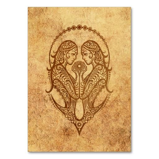 This stylized symbol for the zodiac sign of Gemini is decorated with intricate lines and dot patterns. The symmetrical pattern features two stylized women facing each other with a large circle in behind them. Rough textures and natural colors gives the design an an aged and worn look. This stunning design is a beautiful and stylish way to show of your Astrological sign.