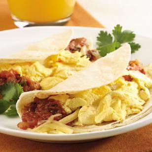 Quick Breakfast Taco.  A smaller cousin of the breakfast burrito, the breakfast taco made with reduced-fat Cheddar and egg substitute is a satisfying and healthy breakfast option. -- EatingWell.com 4 Week Weight Loss Plan