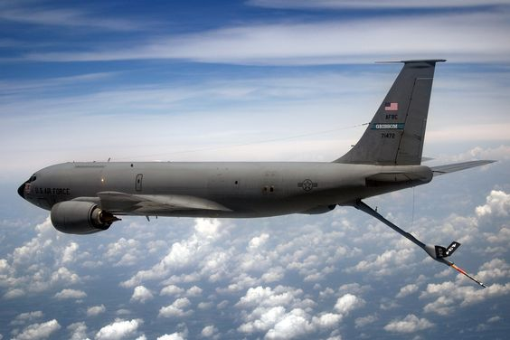 A KC-135R Stratotanker from the 434th Air Refueling Wing at Grissom Air Reserve Base, Ind., flies over Ohio shortly after refueling a C-17 Globemaster III from the 445th Airlift Wing at Wright-Patterson Air Force Base, Ohio, June 18, 2014. The main mission of the KC-135 is to provide inflight refueling to long-range bomber, fighter and cargo aircraft. (U.S. Air Force photo/Tech. Sgt. Mark R. W. Orders-Woempner)