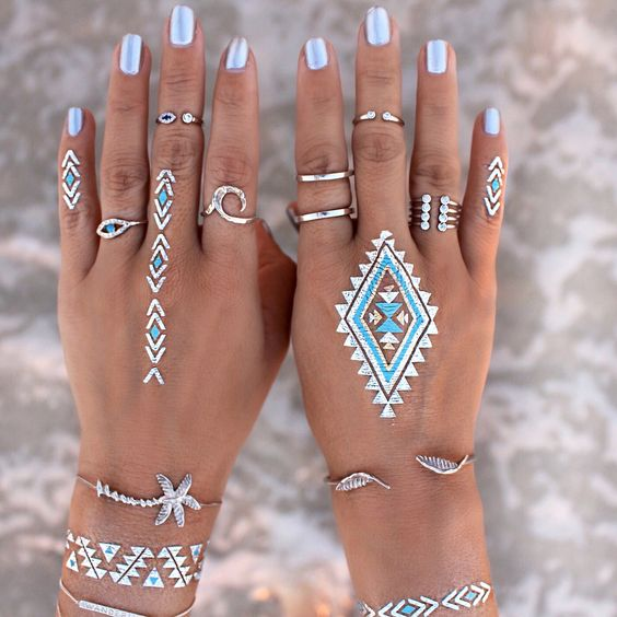 Blue hand tattoos, jewellery and nails. I would love mine to look like this at a festival!:
