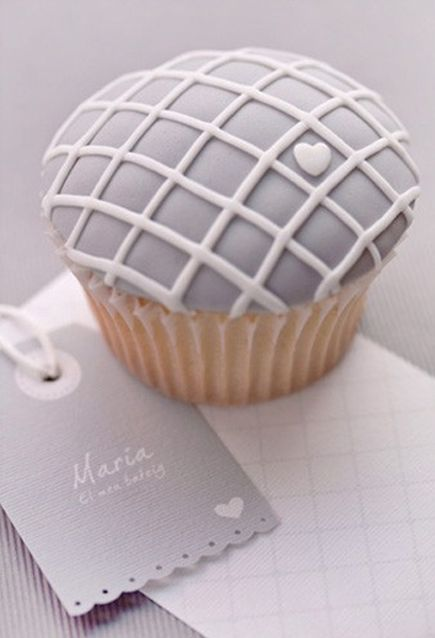 Steal this great (inexpensive) idea…     Create an ornately decorated cupcake that matches your business branding. I love it!