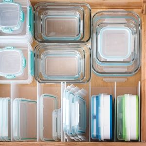 Leftover and Lunch Containers - in a space large enough to accommodate them all. also dividers for lids.