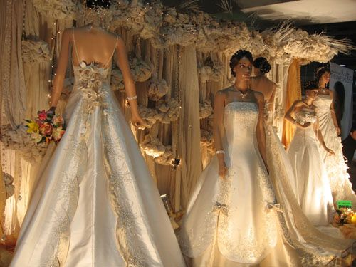a pretty gown with nice detailing in the back - important, as most of us spend most of the wedding viewing the back of the gown!