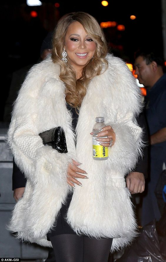 Festive: Unmissably glamorous in a white fake fur coat, the 45-year-old singer was all set...