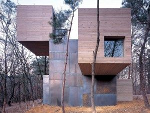 Northern European design. Love how the materials blend and are so sympathetic to the home's surroundings.