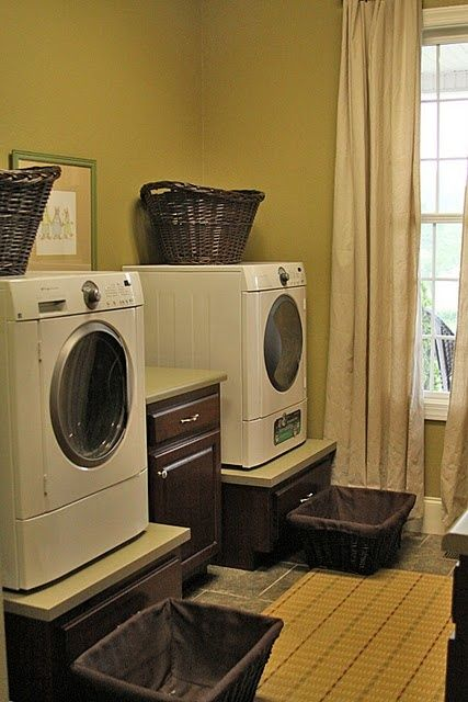 Washer and Dryer stand idea. Like the cabinet in middle for storing soaps and supplies.