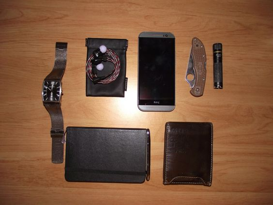 Skagen••Men's 851LTBB + VSonic••GR07 Bass Edition Earbuds + Moleskine••Classic Hardcover Notebook + Fisher••Buller Space Pen + HTC••One (M8) + American Eagle••Leather Bifold + Spyderco••Delica 4 + Fenix••LD15