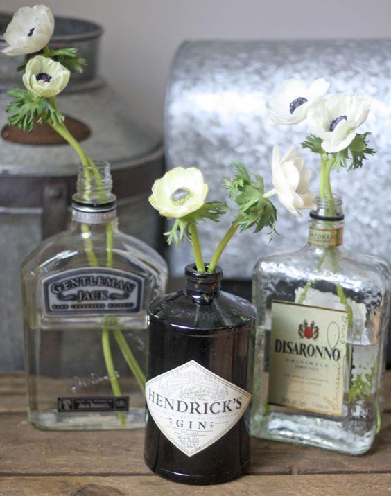 Gin bottles as vases let 39 s get saving them photography for Liquor bottle vases