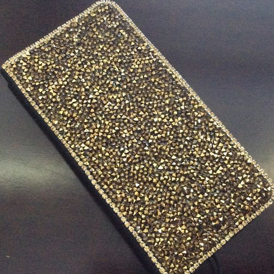 Samsung Galaxy Note 5 Gold Crystals Phone Case New Gorgeous! Golden crystals and PU leather for your Samsung Galaxy Note 5 phone! Elegant, stylish, super sparkly! New! Accessories Phone Cases