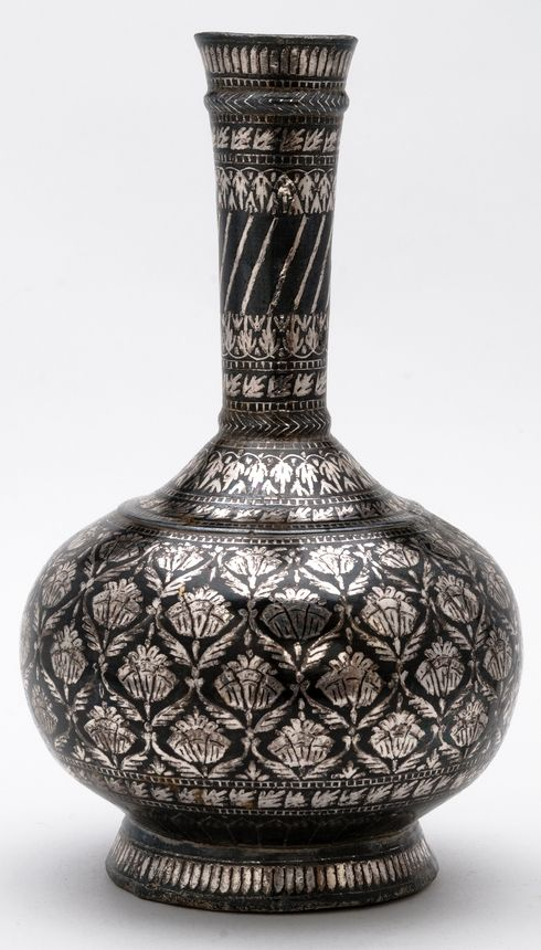 Bidri ware water bottle made of patinated zinc alloy inlaid with silver in a floral design. [...] | Horniman Museum and Gardens | CC0
