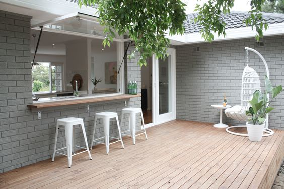 :: Painted Exterior brick, outdoor flow, bar from kitchen ::