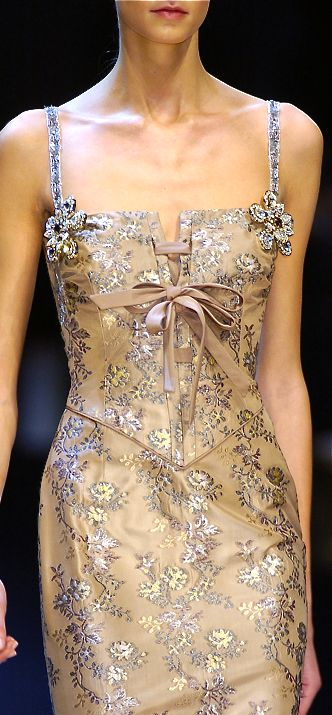Valentino    The delicate construction and gentle colors are warmly appealing.