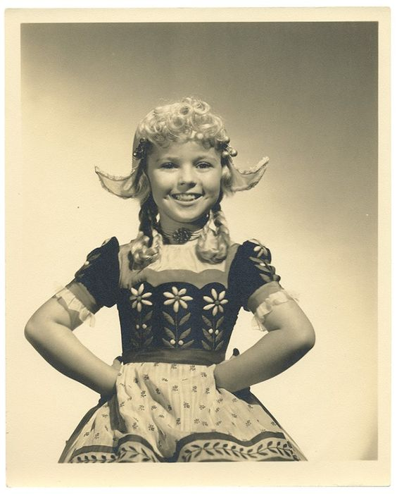 "Shirley Temple in iconic ""Dutch outfit"" from the film, ""Heidi."" See this costume and much more in traveling exhibits and in auction by Theriault's on July 14, 2015. http://www.theriaults.com"