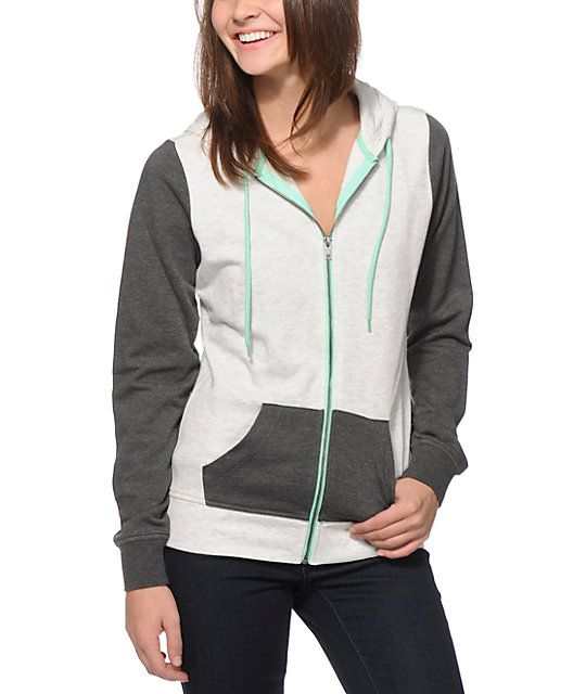 A mint zipper and adjustable drawstrings adds a touch of color to this heather grey and charcoal colorblock hoodie made with a soft fleece construction for comfort.