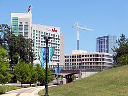 The Woodlands is located 32 miles (51 km) north of Houston along Interstate 45. Though it began as a suburban development and a bedroom community, it also has attracted corporations to the area. As a result, the area features several corporate campuses, most notably Chevron Phillips, Anadarko Petroleum Corporation, Woodforest National Bank, Baker Hughes, CB&I, McKesson Corporation, Hewitt Associates, Maersk Line, and Safmarine.