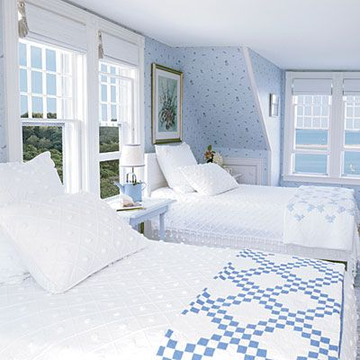 Crisp blue and white beach cottage guest room