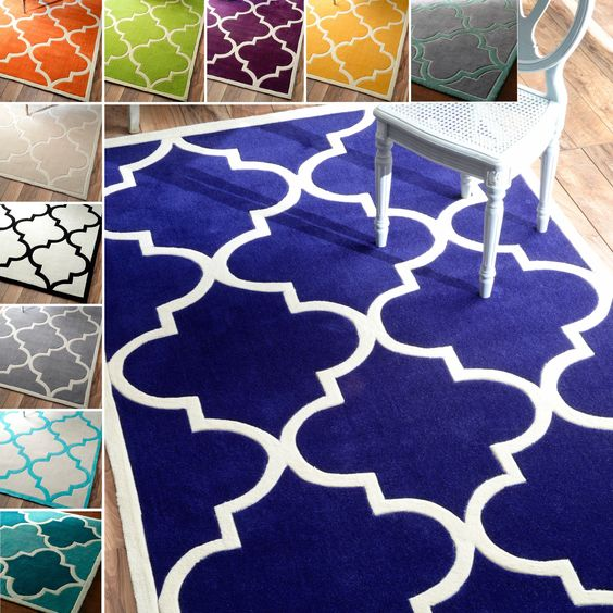 Quality meets value in this beautiful modern area rug. Handmade with modified acrylic to prevent shedding, this plush area rug will enhance any home decor.