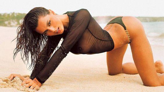 Catrinel Menghia (Rumania, 1985, 1,75m) Hair color: cark brown / Eye color: brown / Measurements: 89-61-89 (35-24-35) / Dress size: 4 (US) / Manager: Next Models / Website: www.catrinelmenghia.ro