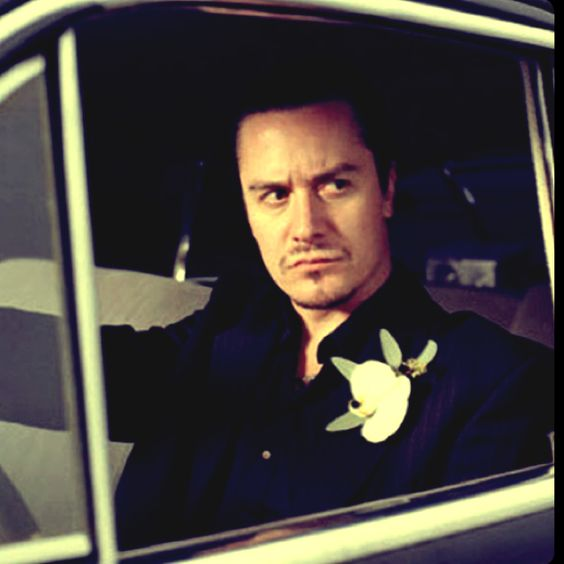 Mike GOD Patton-I walked around with his picture in my wallet for years when I was in my 20's going to concerts. When I went to check out Patton in his new side project Fantomas the wife of the drummer seen it and thought it was cute. She took it from me and had him sign it for me. I still have the picture to this day laminated. I'm just glad I got to see FNM perform in 2010. They are the greatest band ever!