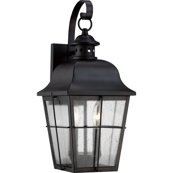 Harking back to colonial lighting, this Millhouse mystic black finished lantern is a handsome look for your home's exterior. Crafted of weather-resistant steel, this lantern houses two 100-watt bulbs and is shaded by seedy glass.