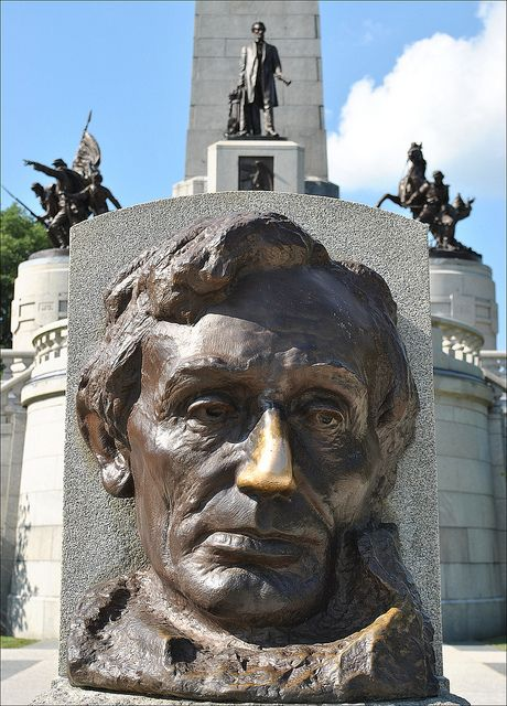 Abe Lincoln-Springfield, IL.  Rub his nose for good luck !