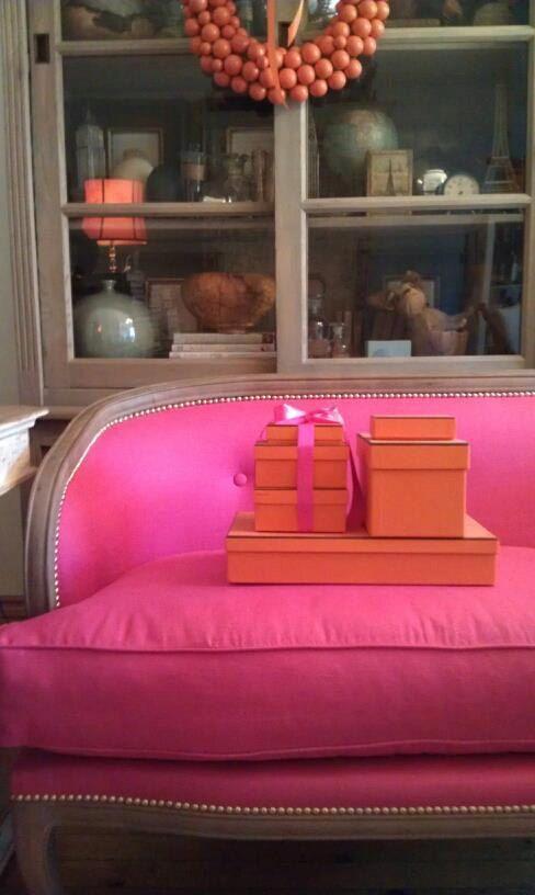 pink sofa, orange Hermes boxes
