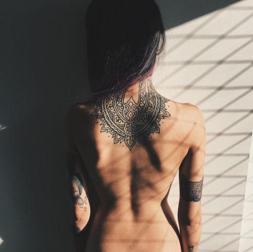 mandala neck and back tattoo