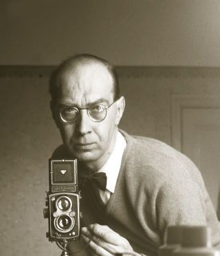 Larkin with his Rolleiflex, 1957.