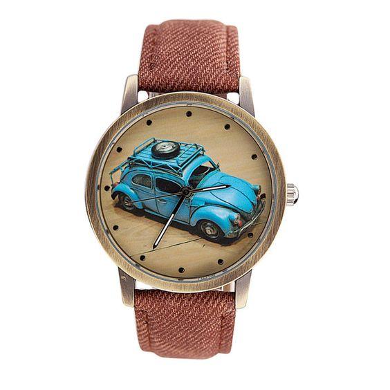 Vintage blue car wrist watch with denim fabric strap. - Movement:Quartz - Band Length:23 cm / 9.1 Inch - Dial Diameter:3.9cm / 1.65 Inch - Band Width:1.7 cm / 0.69 Inch