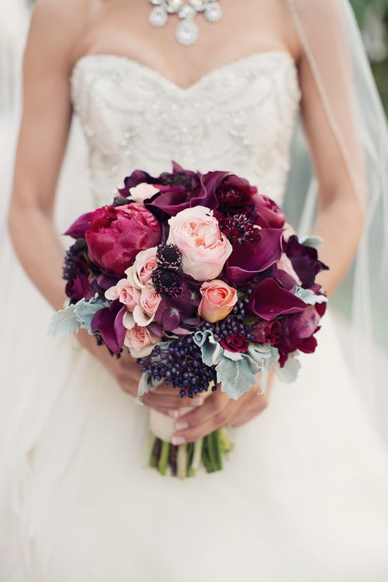 Romantic Burgundy Bouquet - See the wedding here: http://www.StyleMePretty.com/california-weddings/2014/03/27/san-diego-garden-inspired-beach-wedding/ Joshua Aull Photography - www.joshuaaull.com   Floral Design:   Adorations.com   On #SMP