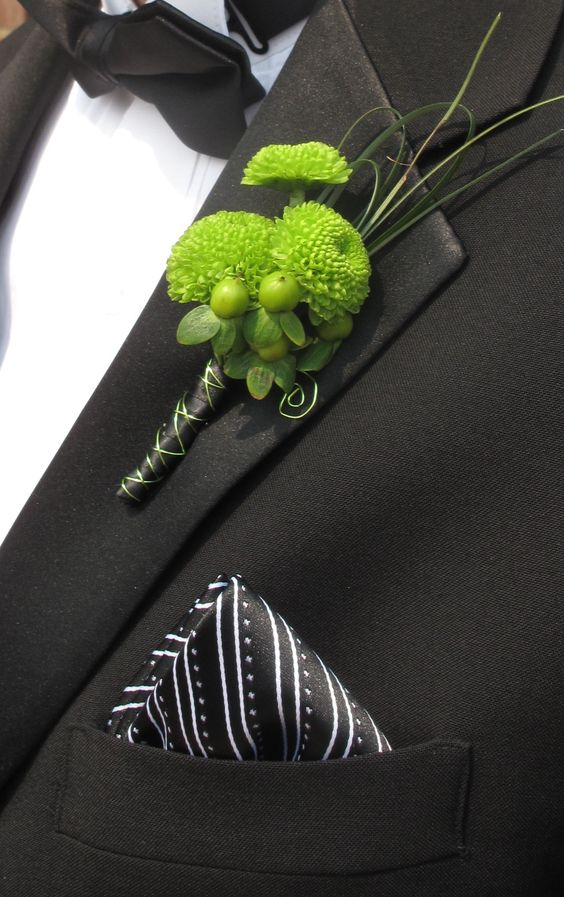 lime green boutonniere. Perfect! (Considering the theme colors are lime green & dark grey!)