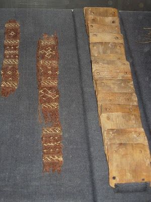 Textiles found on the Oseberg Viking ships shown with tablet-weaving cards.  Bygdøy, Oslo, Norway.