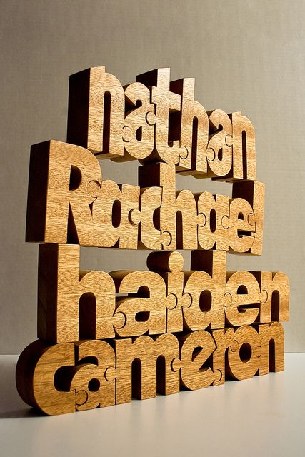 Nuzzles are custom designed wooden typographic puzzles handcrafted by John Christenson since 2008