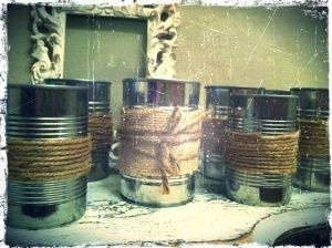 tin cans with burlap and jute twine - easy, cheap and rustic! Could be used for a BBQ or a mans birthday party???