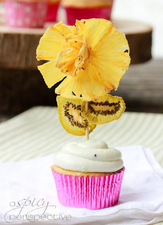 Pina Colada Cupcakes with Fresh Kiwi Frosting via @Sommer | A Spicy Perspective    + Edible Flowers!