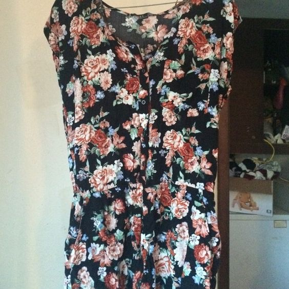 Floral Romper F21 A floral romper from forever 21. it buttons up in the front and is new with tags. Will consider any offer. Never worn Forever 21 Dresses