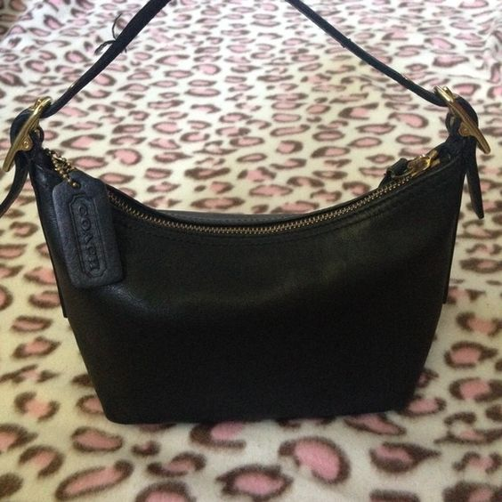 Leather Coach Purse Leather and authentic black Coach purse! RARELY USED! Contains a zipper storage space within the purse and is perfect for storing small necessity items! Coach Bags