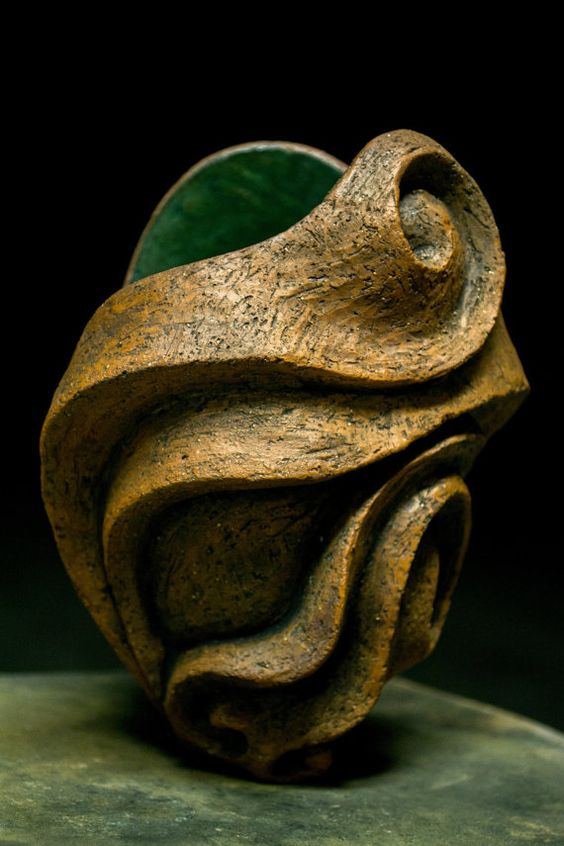Low Fire Clay : This piece is made of low fire terracotta clay with a