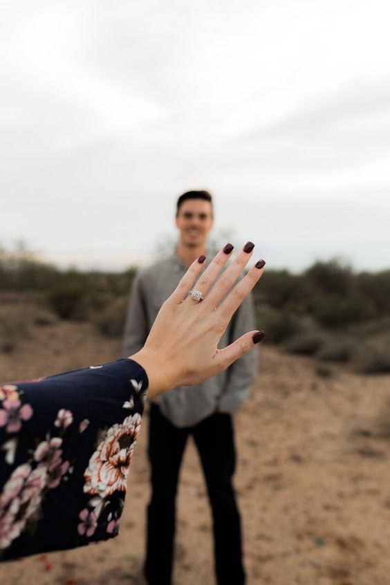This photo is the perfect way to show off the new engagement ring after a proposal!