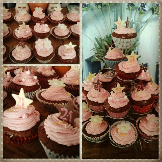 Chocolate cupcakes with pink buttercream icing for a 21st birthday. We got white and milk chocolate stars and wrote '21' on them with writing icing ☺