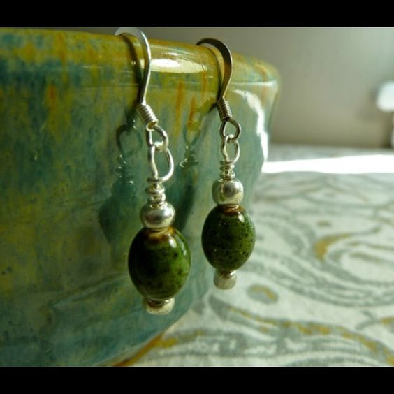 Handmade Green hanging earrings Pretty natural green ceramic bead with two little silver beads. These earrings are 2.5 cm long and 1 cm wide. Handmade by me, brand new. Jewelry Earrings